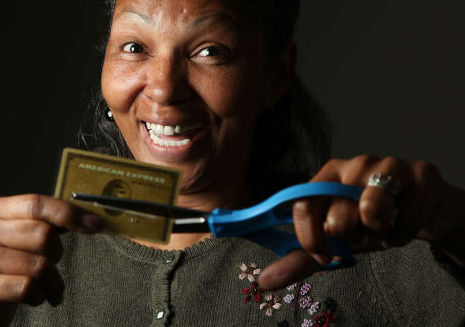 Cherri Gains has paid off half of her credit card debt with the help of the Thrive program. Gains had been using credit cards to supplement her income after she lost her job in the auto industry but turned to the United Way for help getting her finances in order. Photo: Mayra Beltran, Chronicle