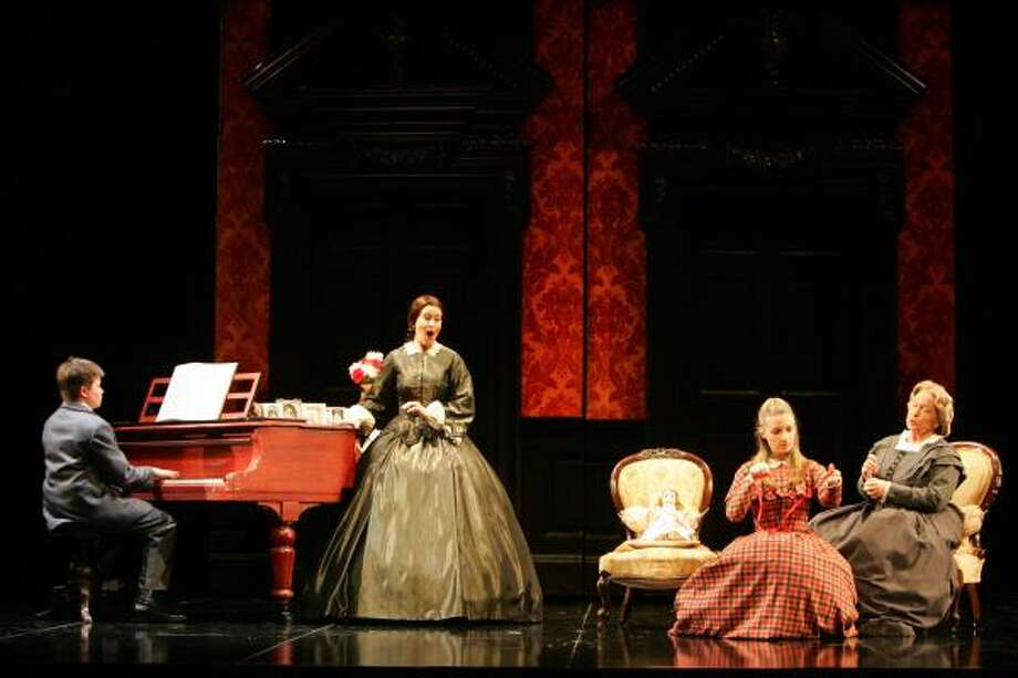 The Governess, her charges Miles and Flora and housekeeper Mrs. Grose are shown in Opera Queensland's 2005 production, one of director Neil Armfield's six previous stagings of The Turn of the Screw. (A different cast stars in HGO's production.) Photo: Rob Maccoll