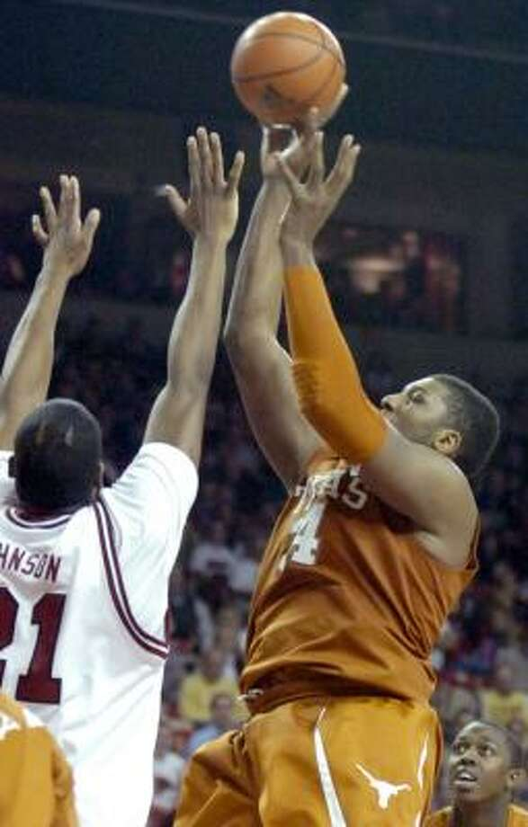 The Longhorns are led by Damion James (16.7 points per game) and Dexter Pittman, above, (14.6 ppg). Photo: April L. Brown, AP
