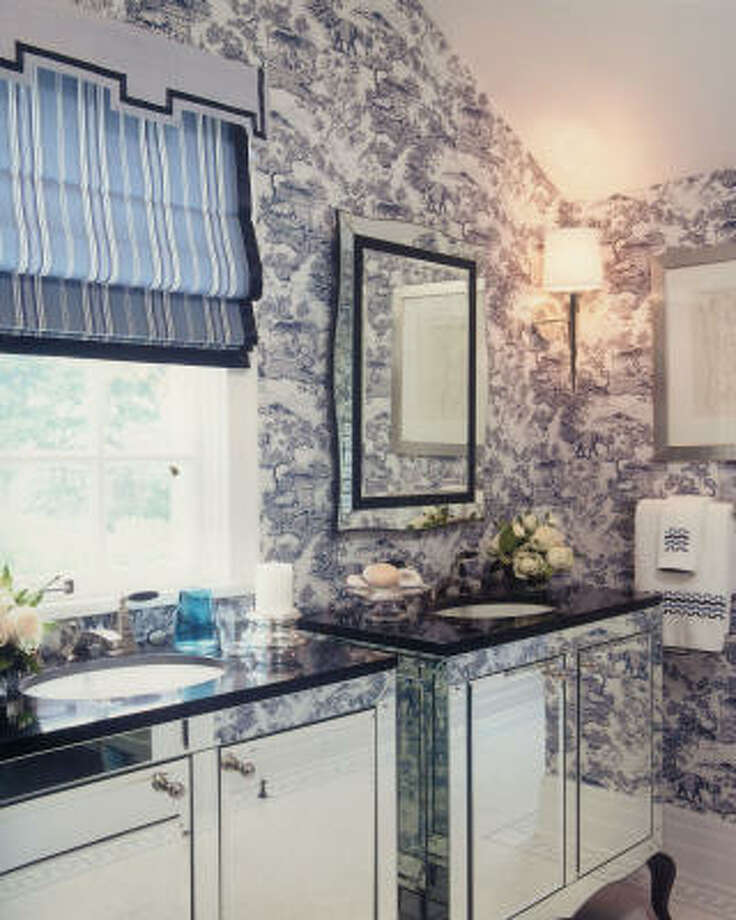 into the looking glass: Designer Barclay Butera aggrandizes a smallish bath with mirrors, mirrors, everywhere.