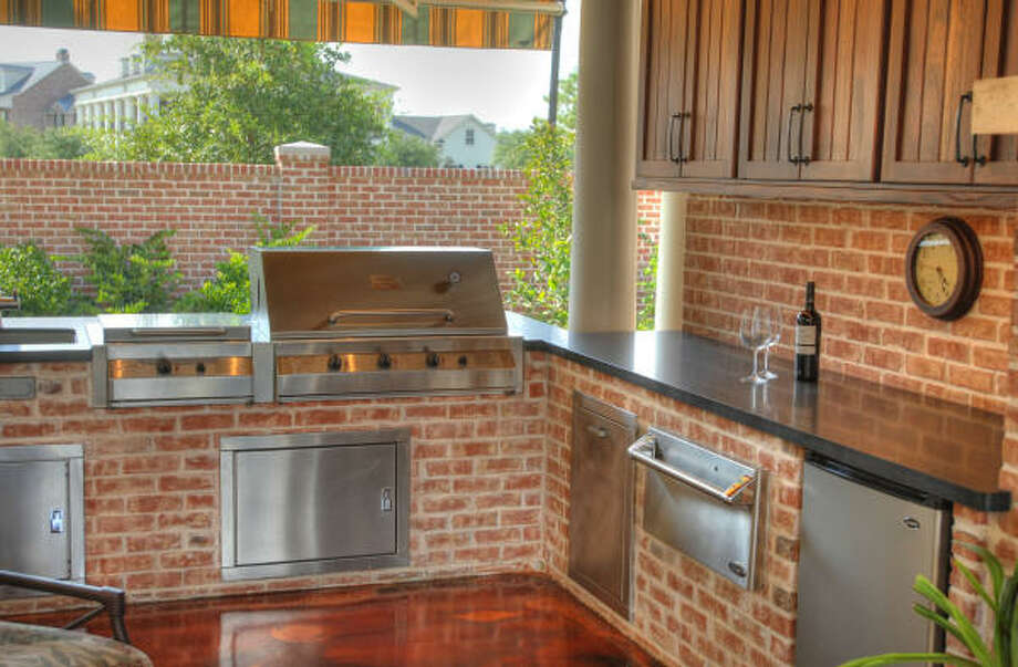 READY TO HEAT THINGS UP?: Many outdoor kitchens include the latest in stainless-steel appliances. Photo: JERRY POWERS PHOTO