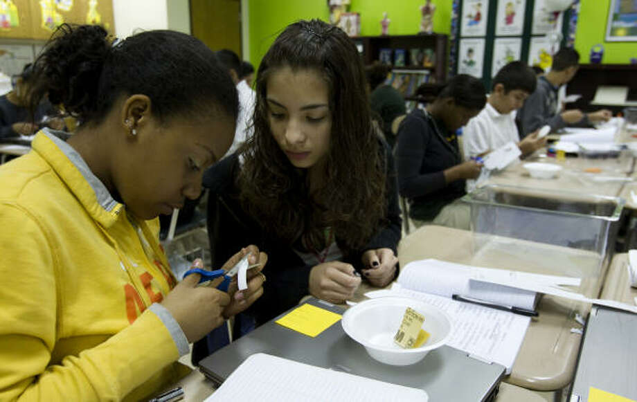 Annia Holmes, left, and Madelin Umanzor create a speaker out of a foam bowl during a science lab at the Energized for Excellence Academy charter school. The campus is ranked No. 2 in the Children at Risk top schools list and is third in the state. Photo: Brett Coomer, Chronicle