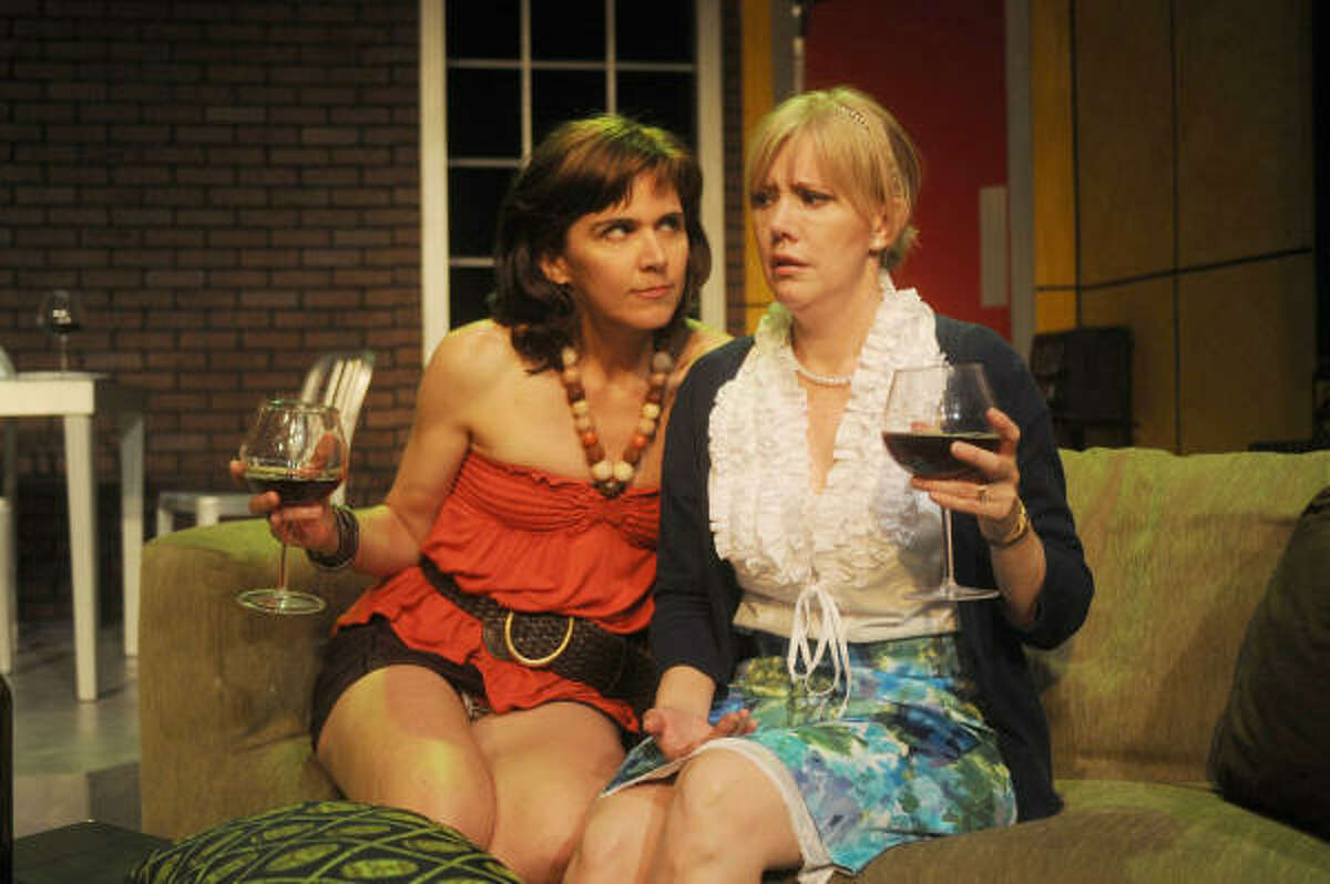 Pam (Shelley Calene-Black, right) and Wendy (Amy Bruce) share wine and a heart-to-heart talk in Catastrophic Theatre's production of Hunter Gatherers.