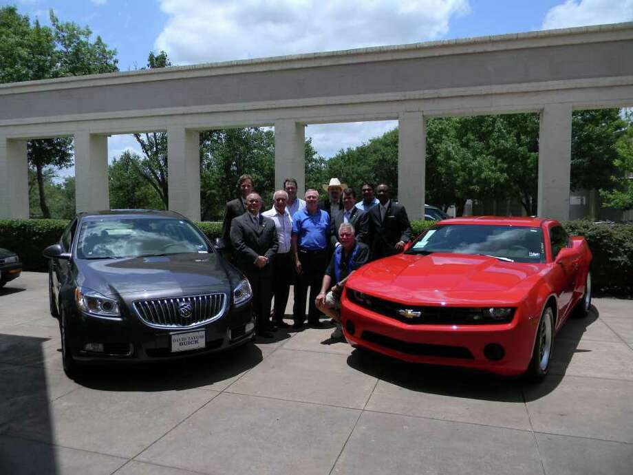 Sugar Land Rotarians are selling raffle tickets for $100 each, and are pictured with the raffle grand prize, a choice of a 2011 Buick Regal or a 2011 Chevrolet Camaro. Pictured from left are Jeff Tallas event co-chair; Craig DeSerf; Bob Bilski; Jared Jameson; Dennis McAfee; Sugar Land Rotary President Greg Pendley; Brian Barnes, Ward Pendleton, Mitch Rahim, event co-chair; and Bouche Mickey. Photo: None