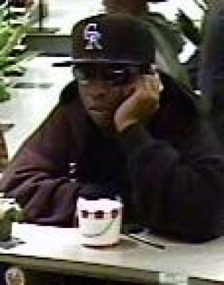 Authorities are looking for this man, who is seen on surveillance video, in the robbery on Monday of a bank in northwest Harris County. Photo: Crime Stoppers