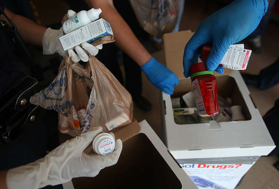 To help prevent drugs from ending up in the wrong hands, a Houston take-back event in September asked residents to hand over unwanted or expired medications. Photo: Mayra Beltran, Chronicle