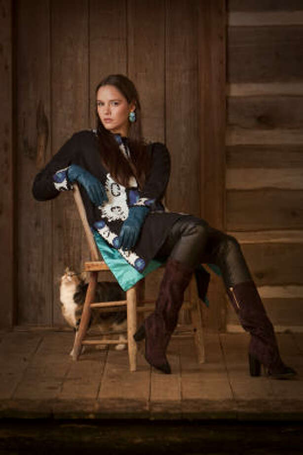Kate Baxter of the Neal Hamil Agency wears an embroidered tunic by Sabira Collection, $415, Diane von Furstenberg pants, $330, and a Rebecca Taylor top, $275, Tootsies. Chanel suede boots, $1,25, and blue leather gloves, $105, Neiman Marcus. Dian Malouf turquoise earrings, $3,025. Photo: Smiley N. Pool, Chronicle