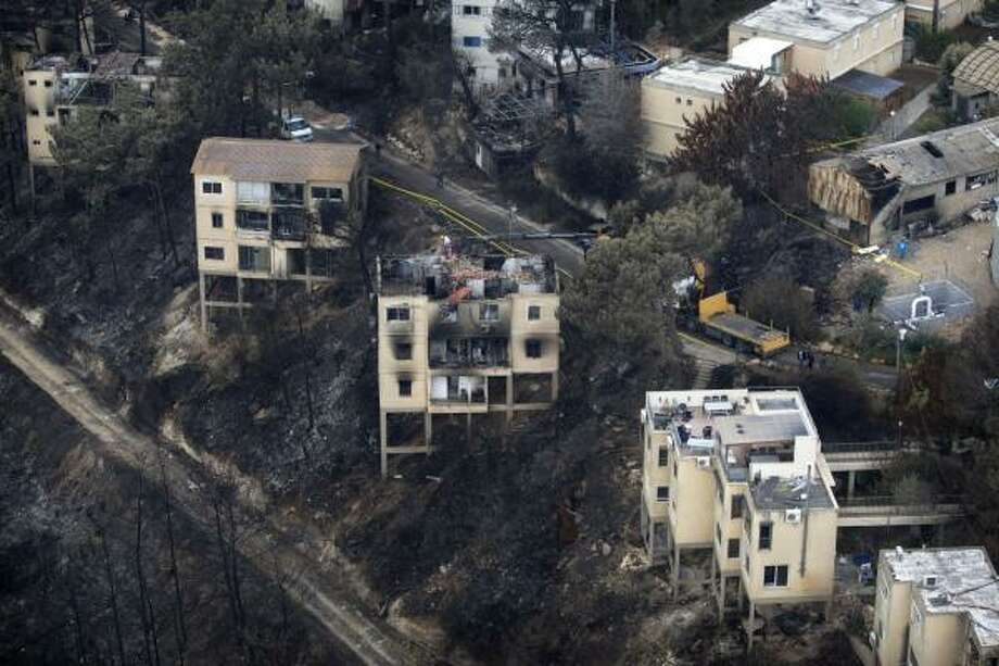 Damaged buildings after a massive wildfire are seen in Kibbutz of Beit Oren in the Carmel, northern Israel. Photo: Sebastian Scheiner, Associated Press