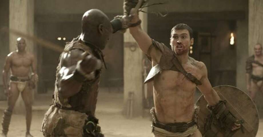 Doctore (Peter Mensah) trains Spartacus (Andy Whitfield) to be a gladiator in Spartacus: Blood and Sand. Photo: Starz