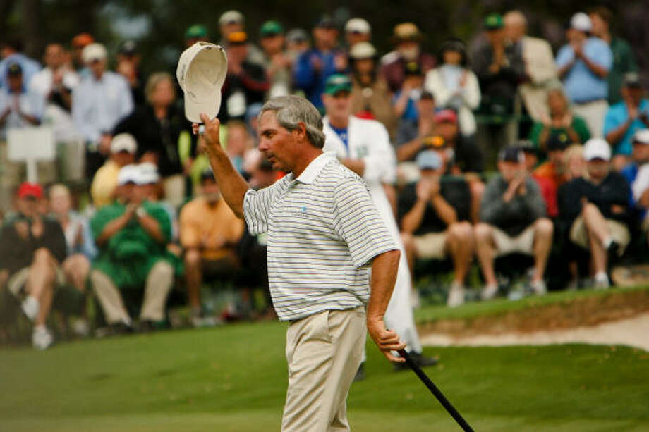 University of Houston alum Fred Couples tips his hat to the crowd after finishing the first round at the Masters. Photo: Tim Dominick, MCT