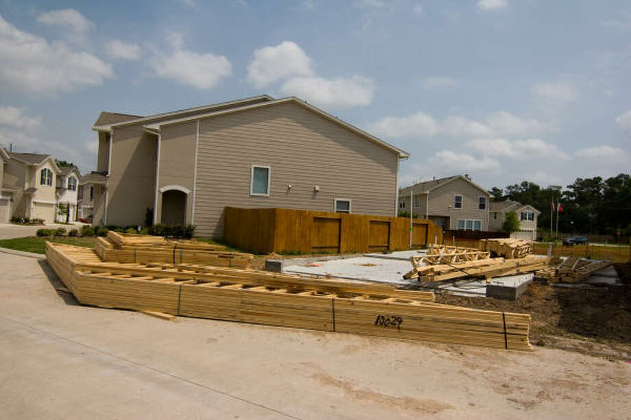 UNDER CONSTRUCTION: The development company is selling three to four town homes each month. Thirty of the 70 remain unsold at the moment. Photo: R. Clayton McKee, For The Chronicle