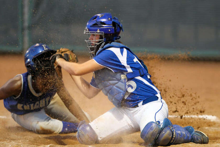 Taylor catcher Andi Stallard, right, makes the game saving tag out on Elkins' DJ Hooks in the seventh inning. Photo: Nick De La Torre, Chronicle