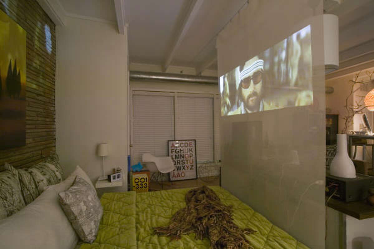 Chris Nguyen used fabric from an IKEA roller blind to create a double-sided projector that also serves as a room divider.