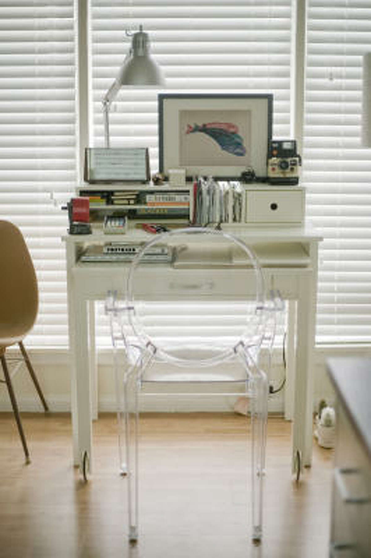 Nguyen paired his West Elm desk with a clear Louis Ghost chair, which reduces visual clutter.