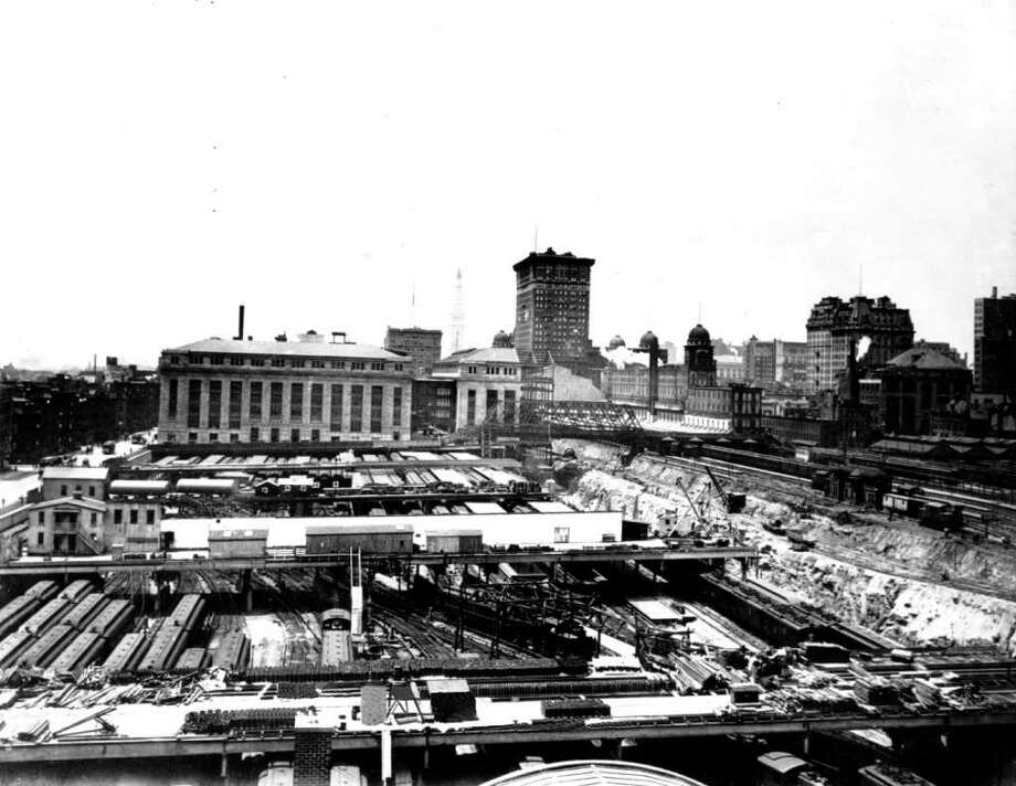 Grand Central Terminal trackage and train yard on June 7, 1909.  At center is the terminal building under construction. Looking south in foreground is E. 49th St. between Lexington and Park avenues. The MTA Transit Museum is looking for Grand Central Terminal artifacts for its centennial exhibit in 2013. Photo: ASSOCIATED PRESS / AP1909