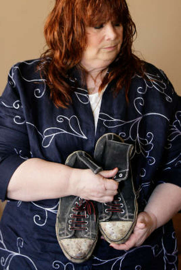Sandi Johnson holds the shoes of her son, Hank Johnson, who died 11 days after being brutally beaten in his hotel room on July 10, 2008. Photo: Melissa Phillip, Chronicle