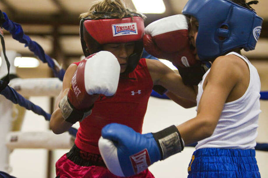 Jody Gauthier, left, connects with a left to Israel Rodriguez's nose en route to winning his bout at the Houston Open Ring Nationals on Friday in The Woodlands. Photo: Eric Kayne, For The Chronicle