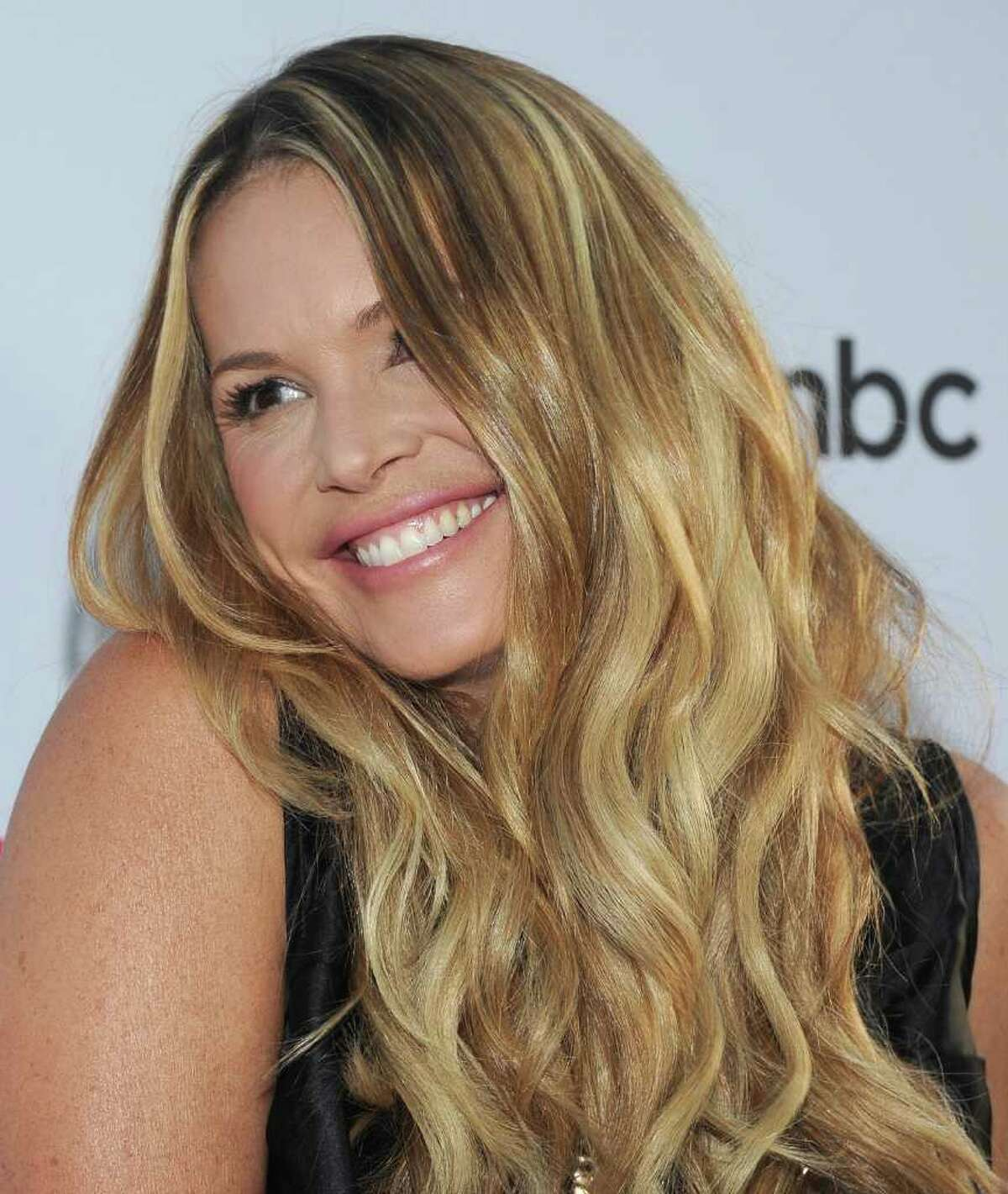 Actress Elle MacPherson arrives at the NBC Universal TCA 2011 Press Tour All-Star Party at the SLS Hotel in Los Angeles, California.
