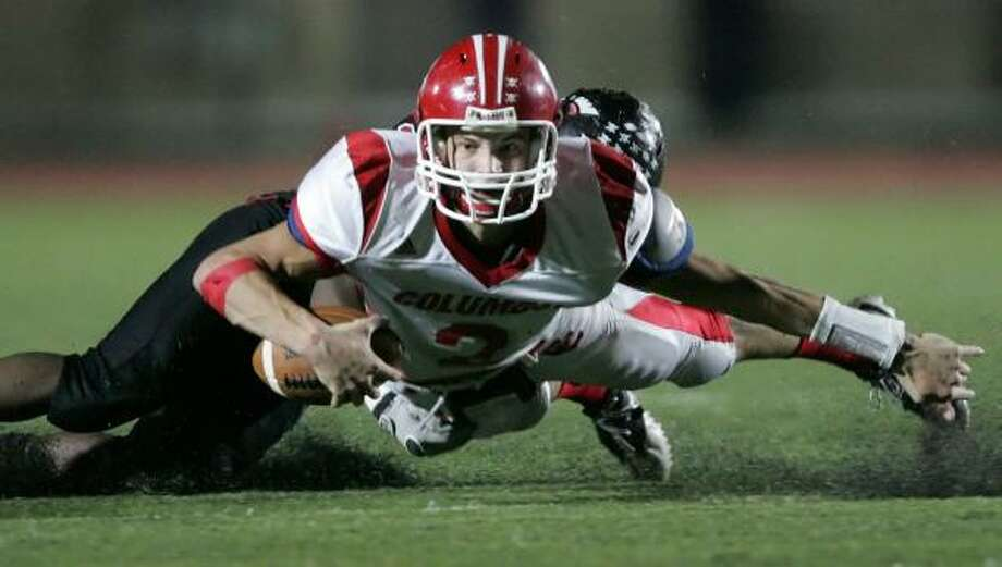 Columbus quarterback Stephen Glueleck is sacked by Coldspring's Tre Cooper during the second quarter on Friday at Turner Stadium in Humble. Photo: ERIC CHRISTIAN SMITH, FOR THE CHRONICLE