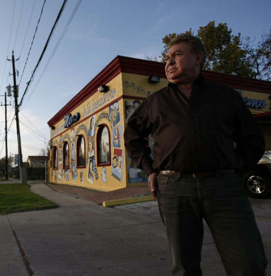 """In one minute, they can destroy you,"" Guillermo Memo Villarreal said of robbers. His Memo Record Shop is a block from the grocery where a robber was killed over the weekend. Photo: Johnny Hanson, Chronicle"