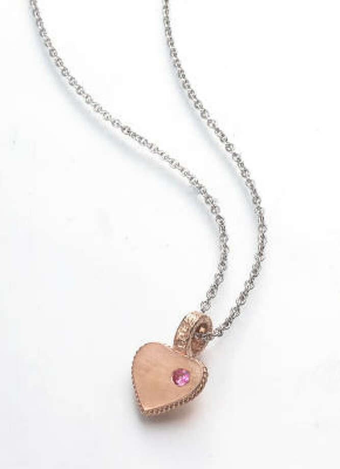 An engraveable heart necklace retails for $270 at www.LeslieGreene.com, at Paul Carter Jewels in Uptown Park or Thomas Markle Jewelers. Photo: Leslie Greene