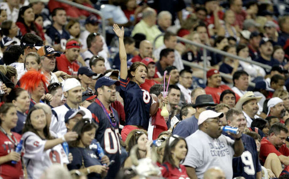 The Texans have sold a record number of season tickets this year even though they increased their prices. Photo: Julio Cortez, Chronicle
