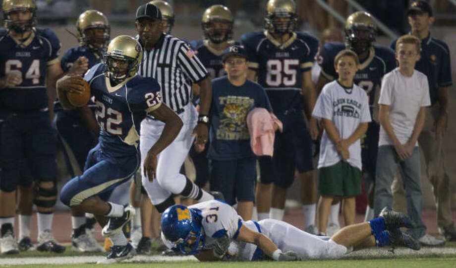Klein Collins running back Marquise Cardinal races for a first down past Klein's Mitchell Nau during the first half on Friday. Photo: Smiley N. Pool, Houston Chronicle