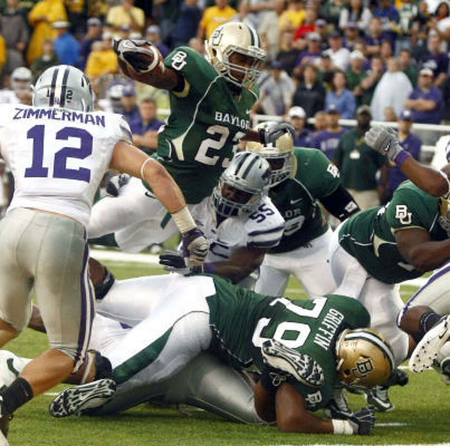 Jay Finley scores for Baylor in the Bears' 47-42 win on Saturday. Photo: Jose Yau, AP