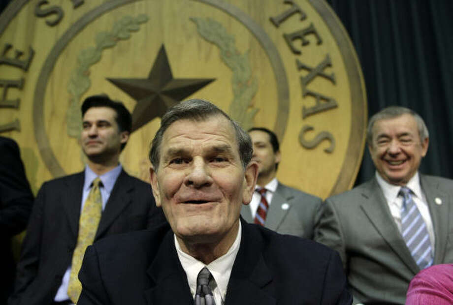 Rep. Edmund Kuempel, R-Seguin, center, was welcomed back to the Texas House of Representatives with a group photo after a heart attack in 2009. Kuempel, well-regarded on both sides of the aisle, died Thursday at 67 after another cardiac arrest Photo: Harry Cabluck, Associated Press