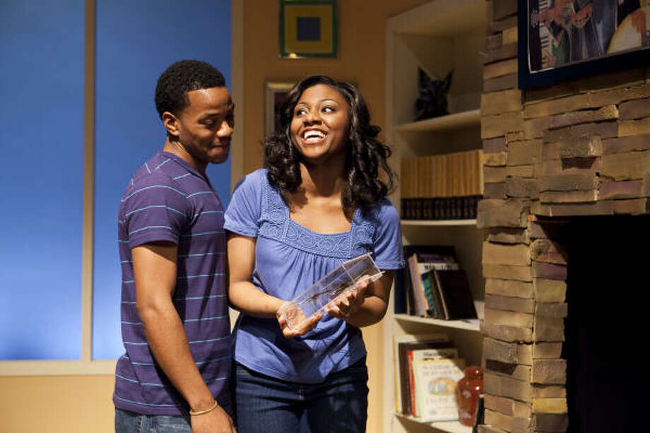 Kent (Kendrick Brown) brings girlfriend Taylor (Estella Henderson) to meet his parents in the Ensemble Theatre's Stick Fly. Photo: Nathan Lindstrom, For The Chronicle