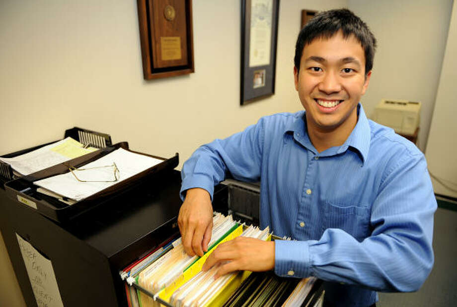 FOR THE PEOPLE: Ron Sung, a family law intern, volunteers for the Houston Lawyer's Program located at 712 Main. This summer he has done pro bono work helping residents with such law-related items as writing wills, assisting with divorces and preparing guardianship papers. Photo: Thomas Nguyen, For The Chronicle