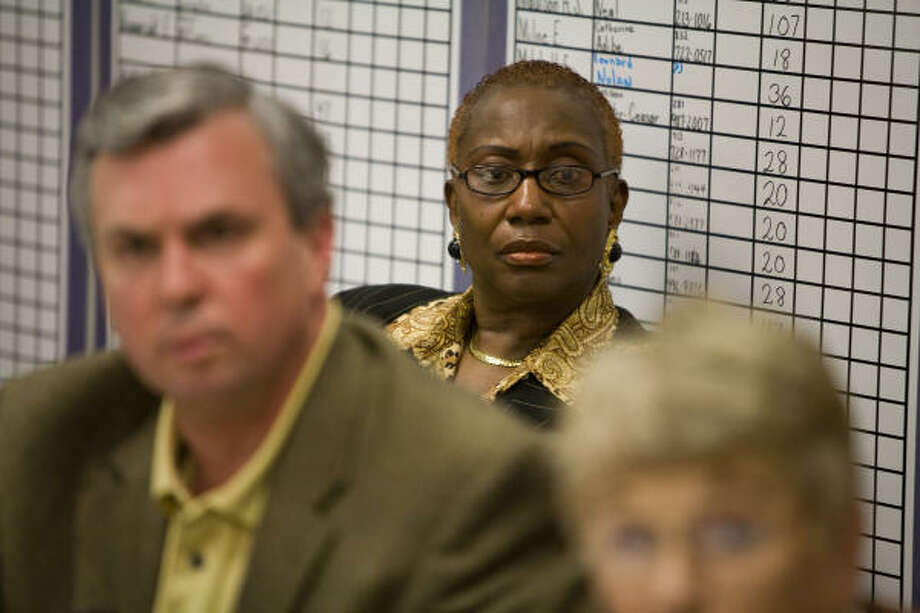 Kashmere High School principal Mabel Caleb, listens to her lawyer Chris Tritico talk about her problems with HISD and her possible termination during a press conference on Thursday, Jan. 21, 2010. Photo: Nick De La Torre, Houston Chronicle