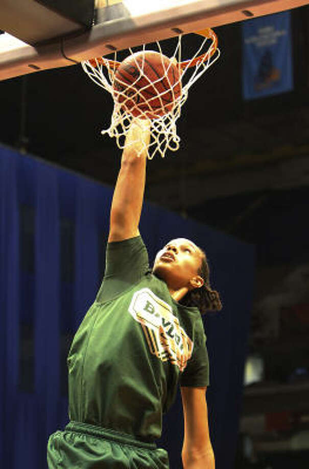 Baylor's Brittney Griner is perhaps the most notable, but she's definitely not the only former Houston high school girls standout making a mark at the next level. Photo: KIN MAN HUI, SAN ANTONIO EXPRESS-NEWS