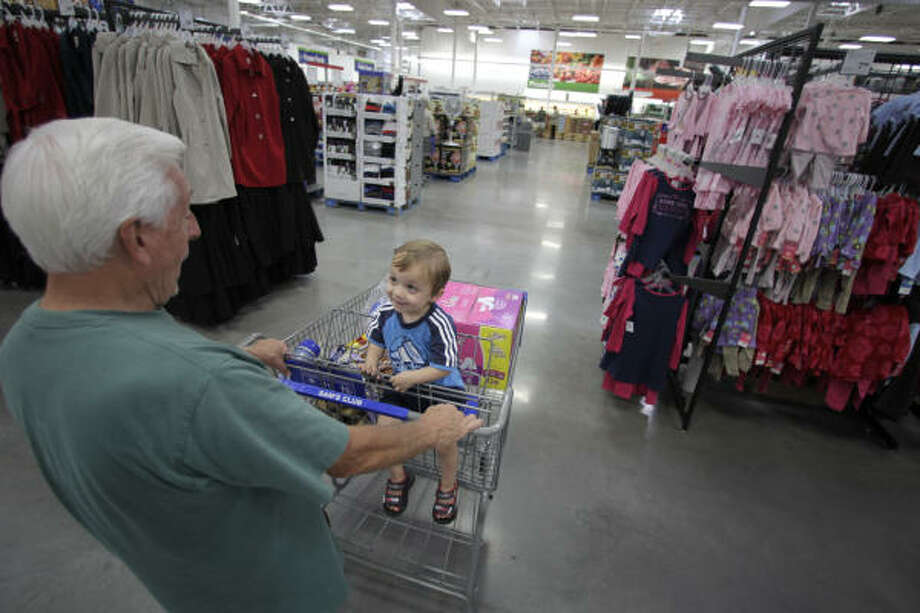 Vince Stanley and his grandson, Nathan Hansche, 2, shop along the widened aisles at the newly remodeled Sam's Club on Interstate 45 in Shenandoah near The Woodlands. Photo: Karen Warren :, Chronicle