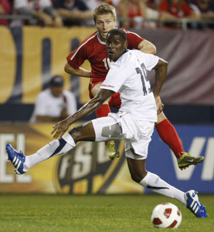 USA defender Maurice Edu, front, and Poland midfielder Jakub Blaszczykowski watch the ball during the first half of an international friendly on Saturday. Photo: Nam Y. Huh, AP