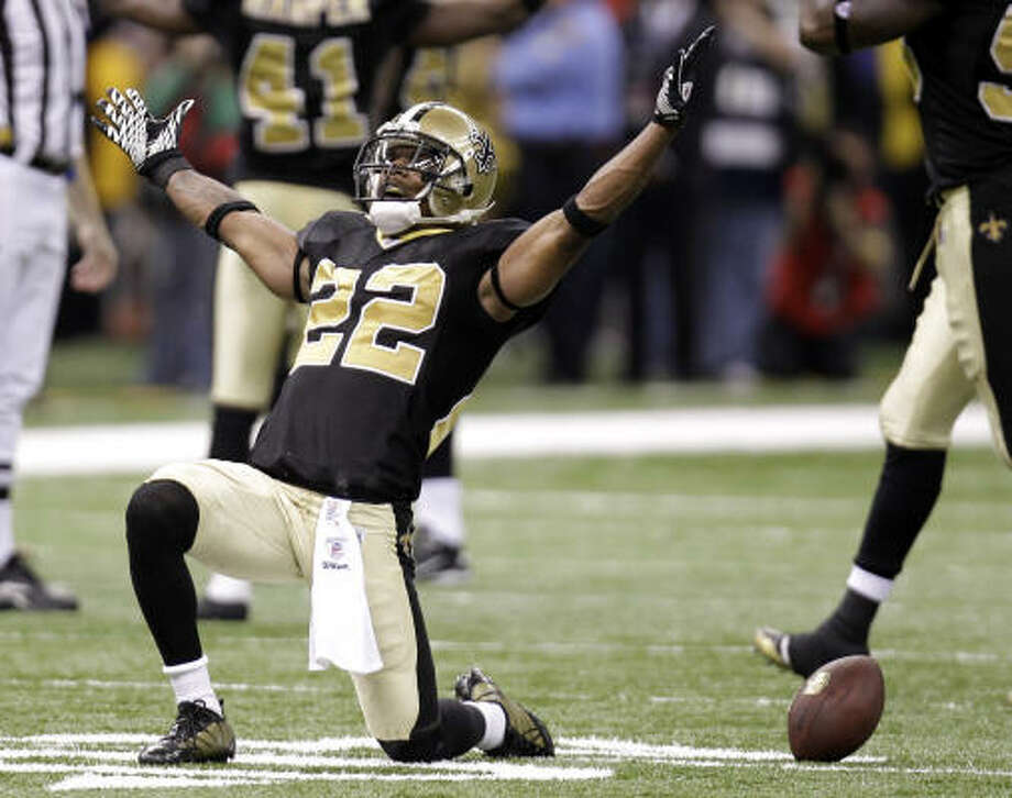 Saints cornerback Tracy Porter celebrates after intercepting a pass by Vikings quarterback Brett Favre. Photo: Bill Haber, AP