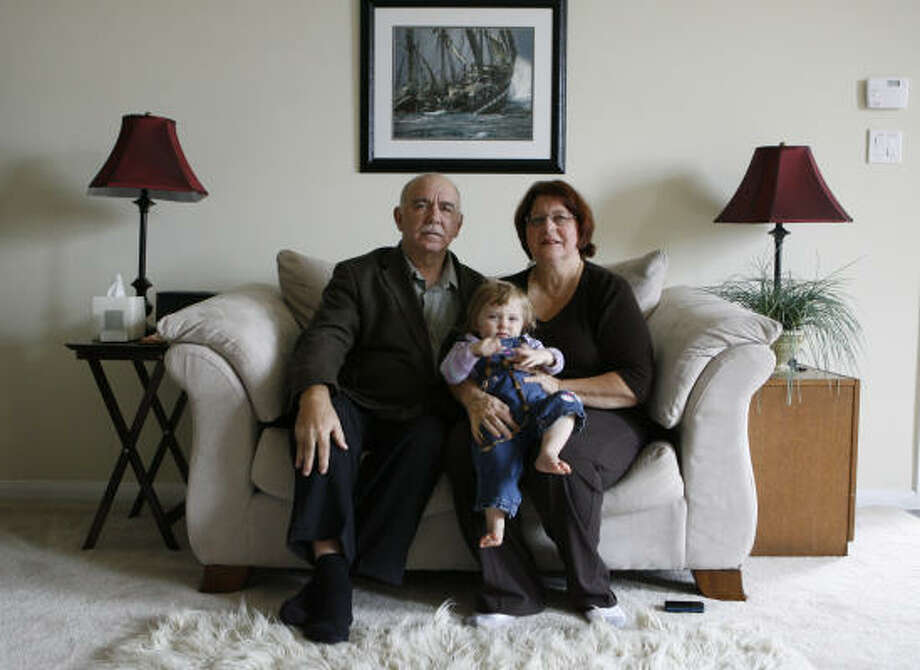 Ernani Stocco, and his wife of 38 years, Karen Stocco, watch granddaughter Emerald, 1, while her parents are at work. The Stoccos met in a New York City subway when Ernani, a native of Brazil who did not know much of the English language, approached Karen, who knew very little Portuguese. Six months later, the two where married. Photo: Julio Cortez, Chronicle