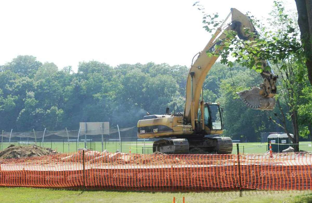 A digger at work in the northern parking lot at Greenwich High School, Tuesday afternoon, Aug. 2, 2011. Greenwich High School playing fields are closed until further notice after testing discovered toxins in the soil unearthed during the auditorium project.