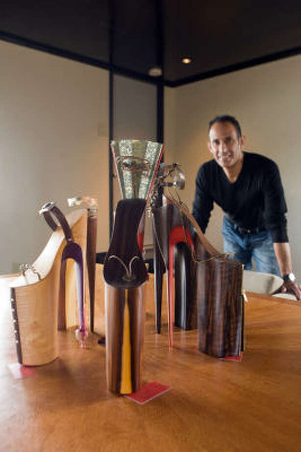 Artist Omar Angel Perez, who creates sculptures of stiletto heels, will meet and greet fans at Surprises boutique on Saturday. Photo: R. Clayton McKee :, For The Chronicle