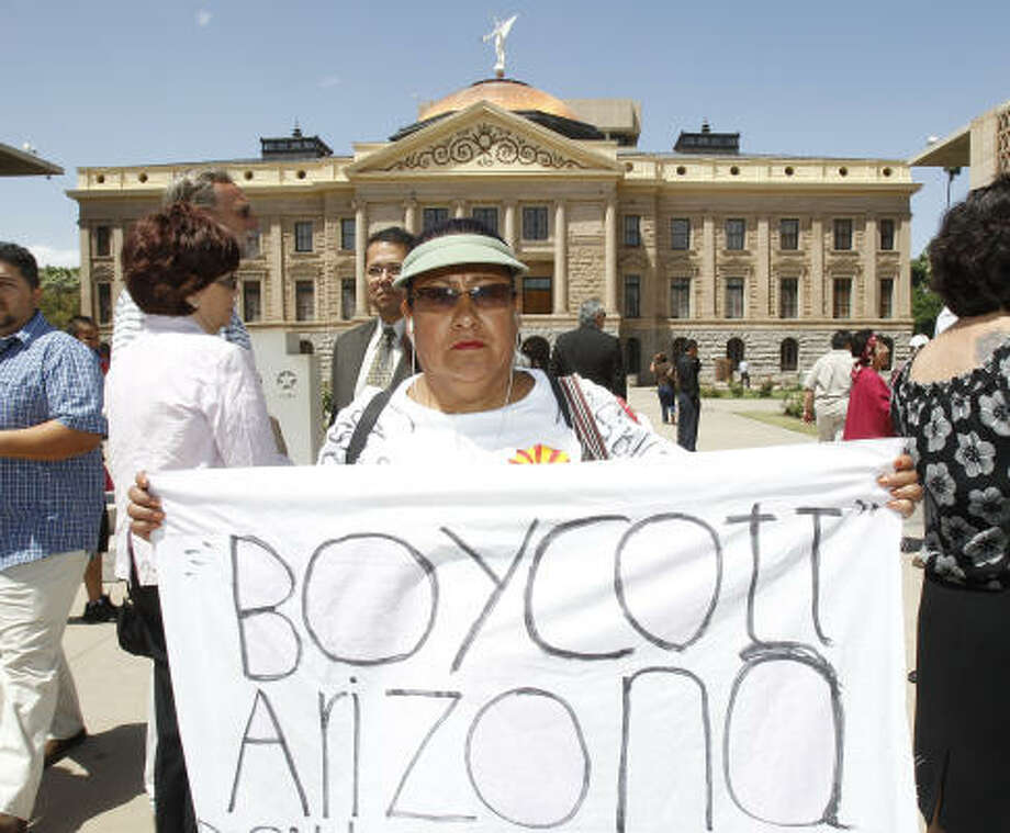 Josephine Nevarez of Phoenix expresses her views at a news conference at the Arizona Capitol in Phoenix. Photo: Ross D. Franklin, AP