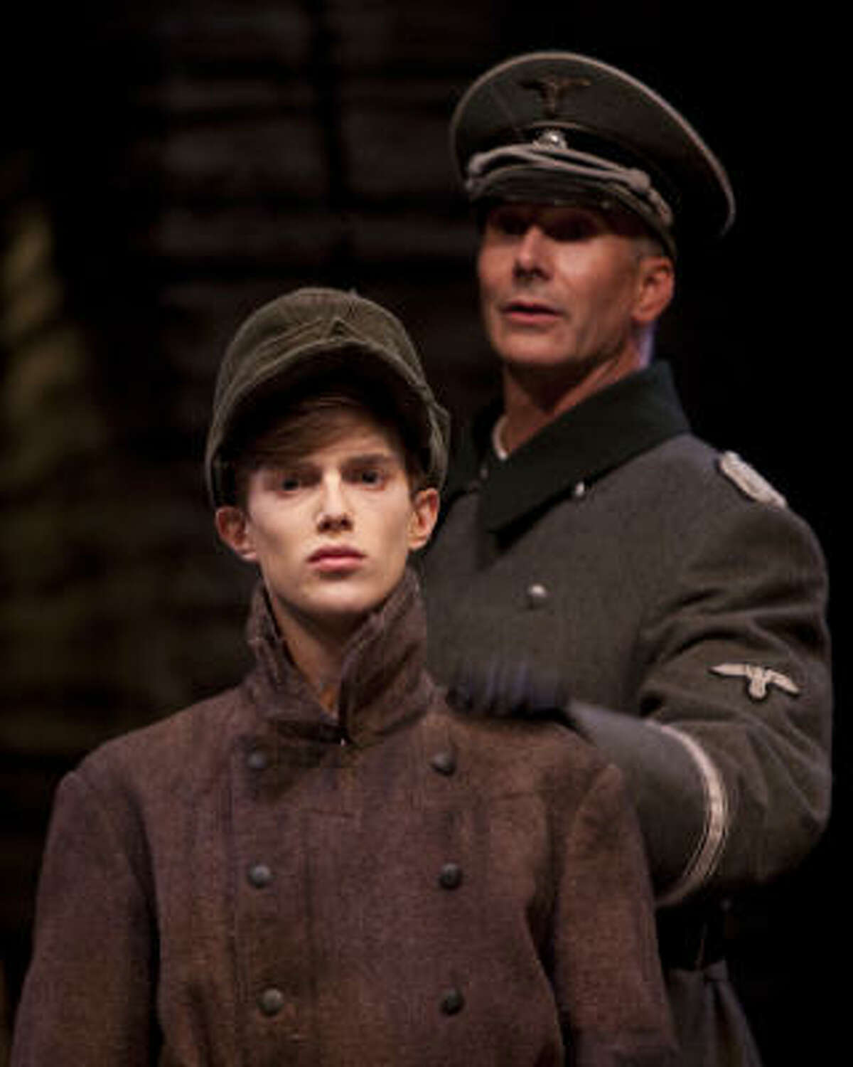 Devout young Nazi Finn Frey (Steven Louis Kane, left) gets his marching orders from Commandant Pister (Todd Waite) in the Alley Theatre's world premiere of Kenneth Lin's Intelligence-Slave.