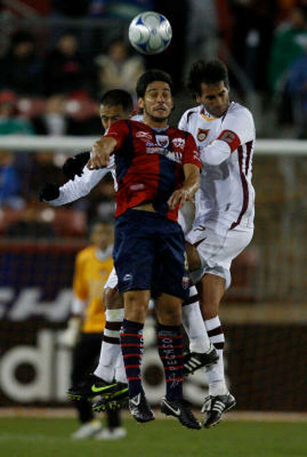 Atlante forward Rafael Marquez, front, goes up in the air against Estudiantes Tecos players Marcelo Guadalupe Alatorre, left, and Juan Carlos Leano. Photo: Julio Cortez, Chronicle