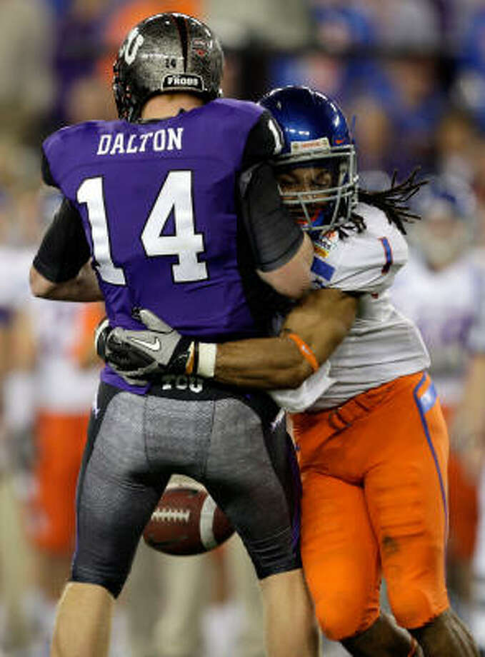 Kyle Wilson sacks TCU quarterback Andy Dalton for what would be a 10-yard loss after TCU recovered the fumble. Photo: Jamie Squire, Getty Images