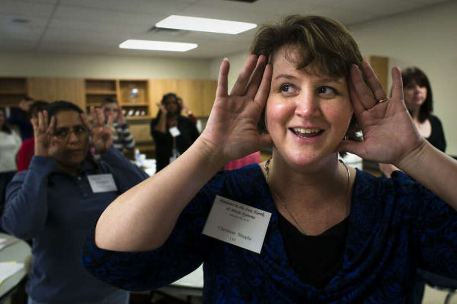 Christine Shupla demonstrates how the solar system works to teachers training for a new science curriculum at the Harris County Department of Education. Photo: Eric Kayne, For The Chronicle
