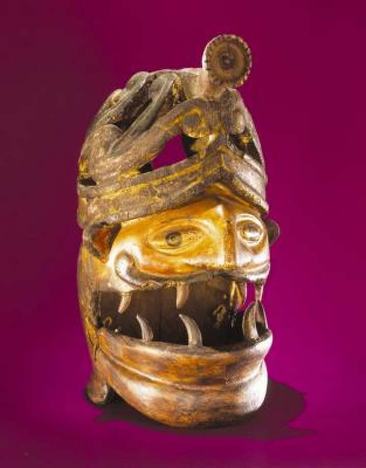 This 18th-century centurion helmet mask is one of the oldest and rarest pieces in the Rockefeller collection. The mask is attributed to the Valley of Toluca in Mexico. Photo: Courtesy San Antonio Museum Of A