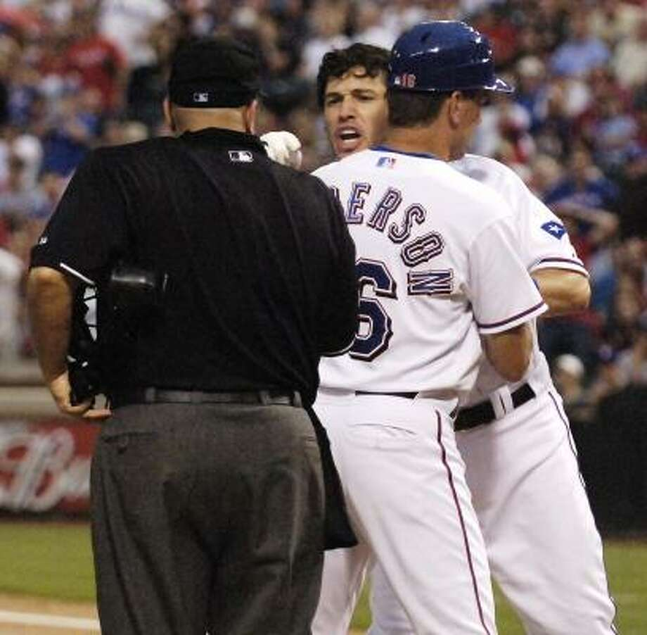 Texas Rangers second baseman Ian Kinsler argues after being ejected by umpire Eric Cooper. Photo: Cody Duty, AP