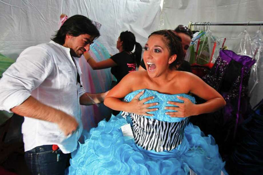 Heather Gonzalez reacts as she hears it's her time to take to the runway as stylist Hugo Longoria (left) preps her during the fashion show at the Verizon My Fabulous Quince Expo in the parking lot of the Northline Verizon Wireless Communications Store, Saturday, July 23, 2011, in Houston.   Expo visitors can get tips on planning the perfect quinceañera on any budget, as well as offers from local vendors. Those who donate an old wireless phone at the expo will receive a VIP pass to meet-and-greet Latin singer Prince Royce.  ( Michael Paulsen / Houston Chronicle ) Photo: Michael Paulsen, Staff / © 2011 Houston Chronicle