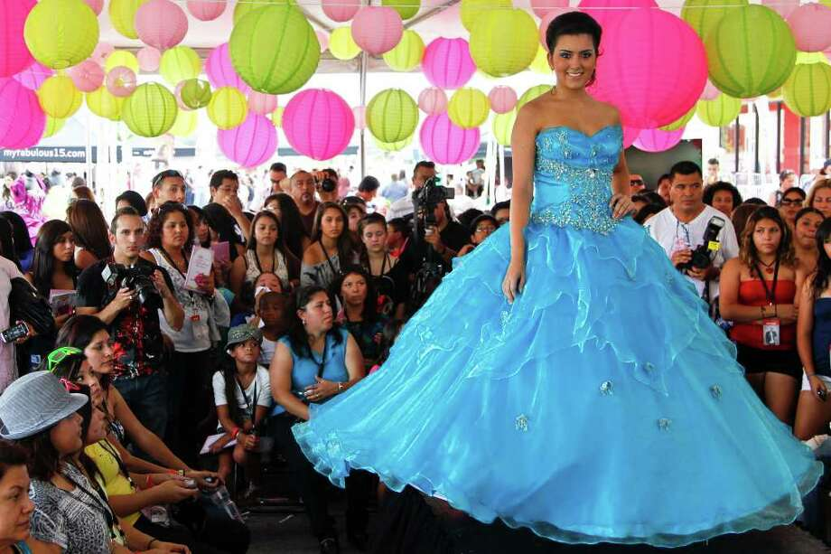 """1. Quinceañeras celebrate a teenage girl's coming of age: Quinceañeras can be seen as a Sweet 16 except celebrated a year younger, when the celebrant is 15 years old – hence the """"quince"""" in quinceañera. During this time, the girl is honored for her maturity, according to The Changing Face of Mexico, a research paper from the UNC School of Education. Photo: Michael Paulsen, Staff / © 2011 Houston Chronicle"""
