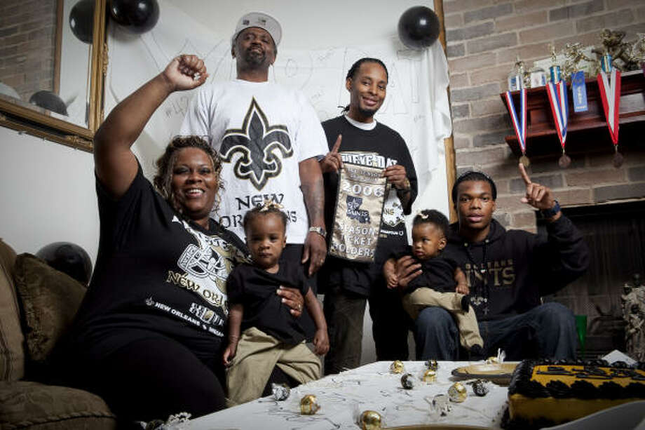 The Williams family (from left) — Yvette, 10-month-old Mikya, Michael, Andwell, 7-month-old Daysha and Edwin — will be cheering on the Saints during Super Bowl XLIV. Edwin, a Westbury High School senior, is one of many area high school athletes who have ties to New Orleans. Photo: Nathan Lindstrom, For The Chronicle