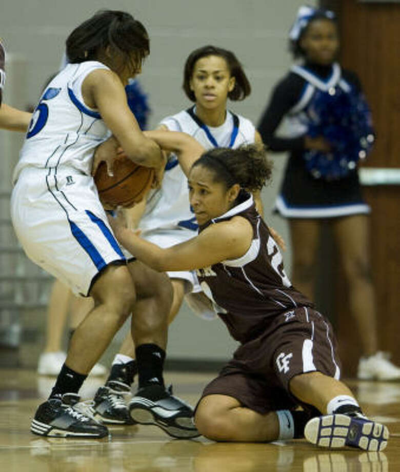 Cassie Peoples, right, and her Cy-Fair teammates are two wins away from a fourth consecutive Class 5A girls basketball state tournament appearance. Photo: Brett Coomer, Chronicle